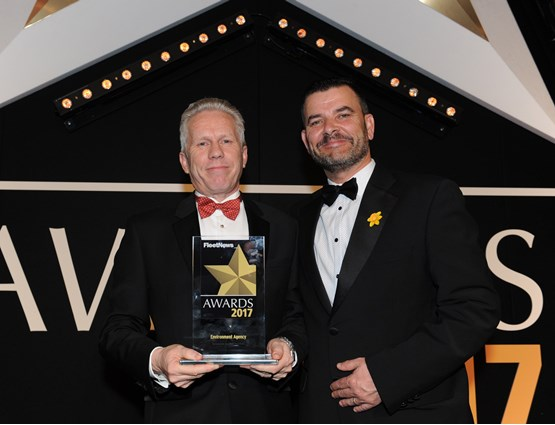 Dale Eynon, head of Defra group fleet services (left), collects the award from Neil Broad, general manager, Toyota & Lexus Fleet
