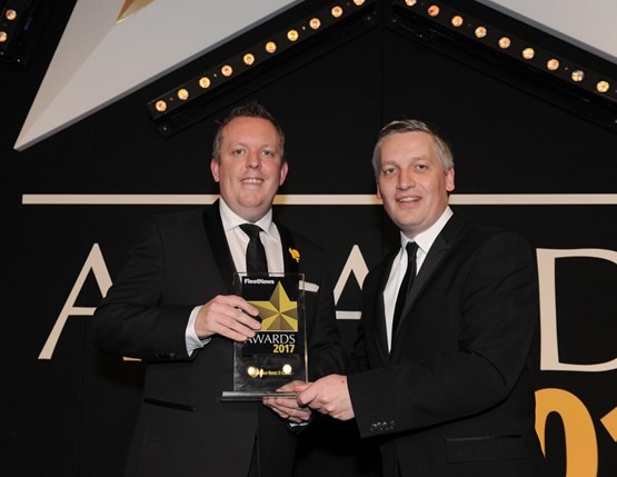 Mercedes-Benz Cars UK head of fleet Rob East (left) collects the award from Elliot Scott, fleet director of Thrifty Car & Van Rental