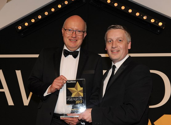 Jon Wackett, UK fleet and business general manager, Jaguar Land Rover (left), receives the award from Elliot Scott, fleet director, Thrifty Car & Van Rental