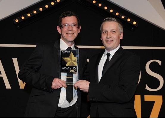 James Taylor, fleet sales director, Vauxhall (left), collects the award from Elliot Scott, fleet director, Thrifty Car & Van Rental