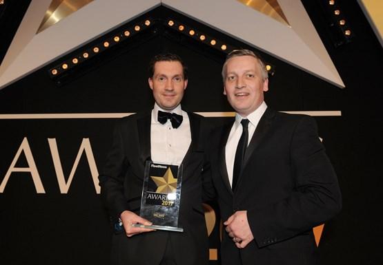 Peter McDonald, Seat UK head of fleet & business sales (left), picks up the award from Elliot Scott, fleet director, Thrifty Car & Van Rental