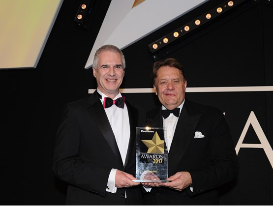 Hyundai national fleet sales manager Paul Williams (left) was presented with the award by transport minister John Hayes CBE