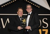 Transport minister John Hayes CBE hands the award to BMW Group general manager, corporate sales Steve Oliver