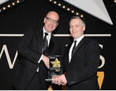 Martin Gurney, PSA Group director – fleet and used vehicles (left), is presented with the award by Elliot Scott, fleet director, Thrifty Car & Van Rental