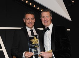 Royal Mail fleet director Paul Gatti (left) collects   the trophy from Zenith commercial director Ian Hughes