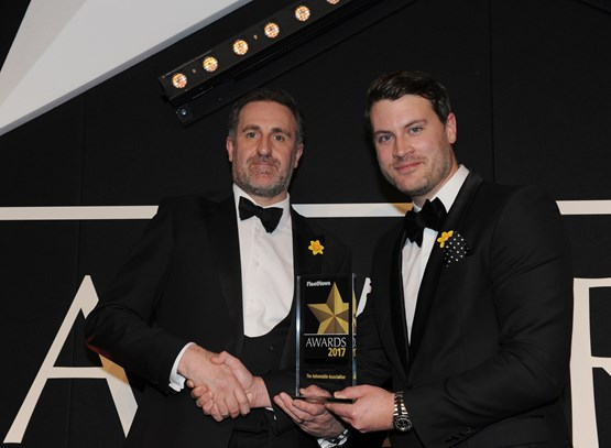 Stuart Thomas, head of fleet services and SME at The AA (left), receives the award from Škoda UK head of fleet Henry Williams