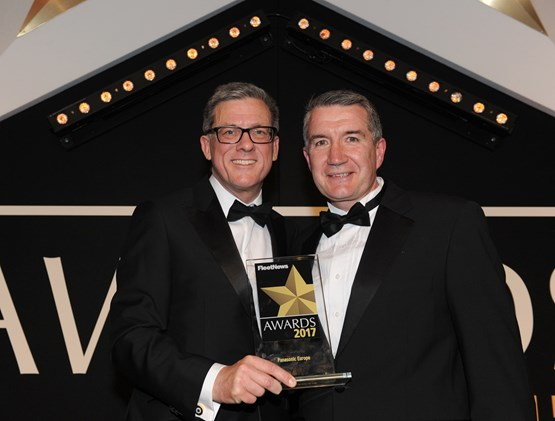 Panasonic Europe senior manager Jason Plummer (right) receives the award from Steve Oliver, general manager, corporate sales, BMW Group UK