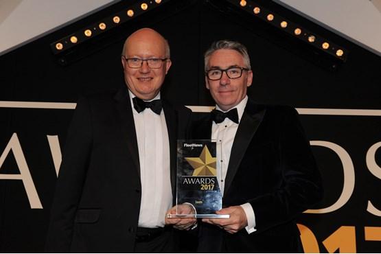 Jaguar Land Rover fleet and business general manager Jon Wackett (left) presents the trophy to Zenith chief executive officer Tim Buchan