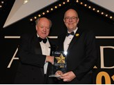 Chairman of the judging panel Christopher Macgowan OBE (left) presents the award to FleetCheck managing director Peter Golding
