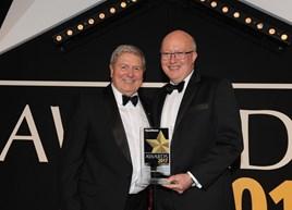 Ian Hill (left), of Activa Contracts receives the Fleet News award from Jon Wackett, of Jaguar Land Rover