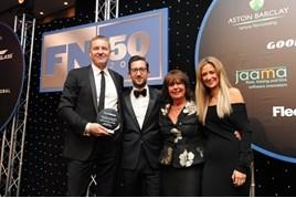 Tusker CEO David Hosking (left) receives the John Leigh Outstanding Achievement Award from John Leigh's family