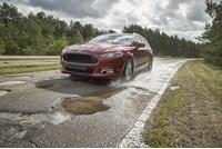 Ford, Ford pothole mitigation technology, potholes.