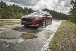 Ford, Ford pothole mitigation technology, potholes.