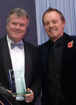 Roddy Graham, of Leasedrive VELO accepts the Leasing Personality of the Year Award from Fleet News' editor Martyn Moore