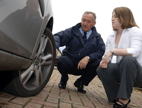 Emma Cole, Fleet News' reporter carries out checks on her car prior to driver training with Drive & Survive assessor Ian Winfield.